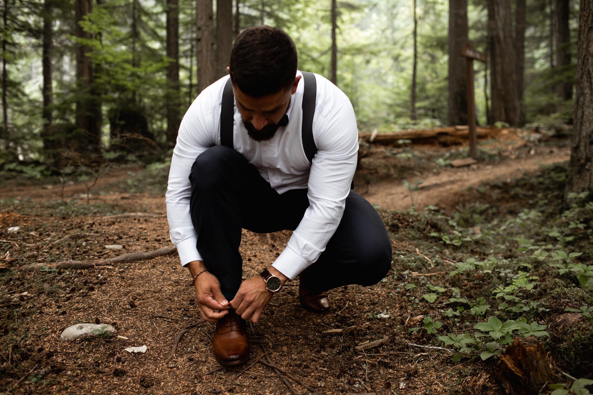 groom tying up shoe