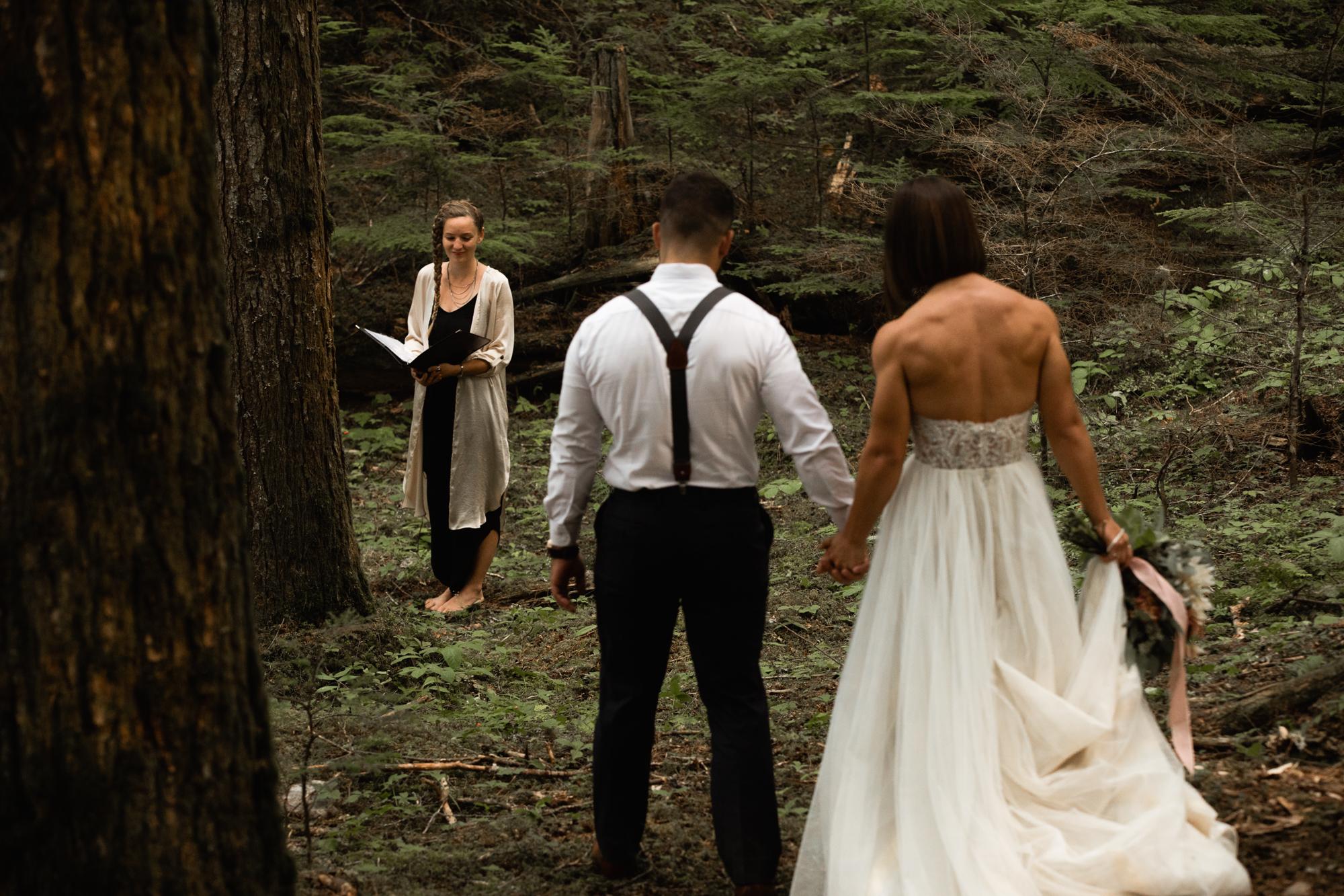 bride and groom walking to elopement ceremony