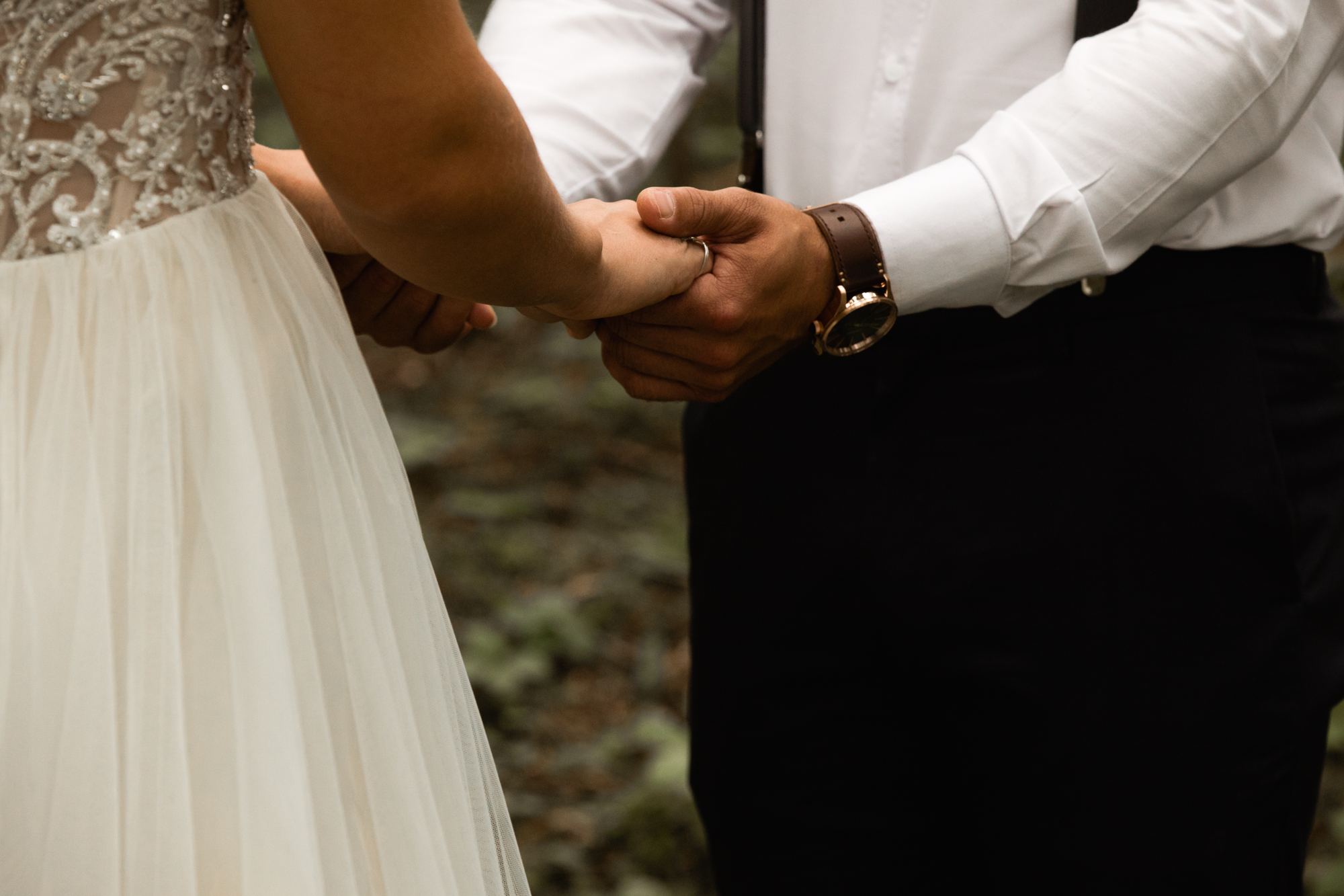 bride and groom holding hands
