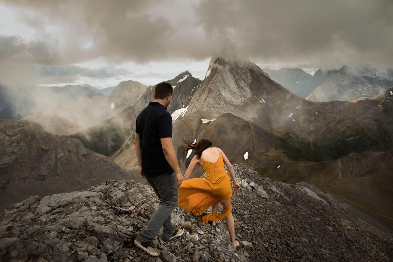couple hiking up mountain