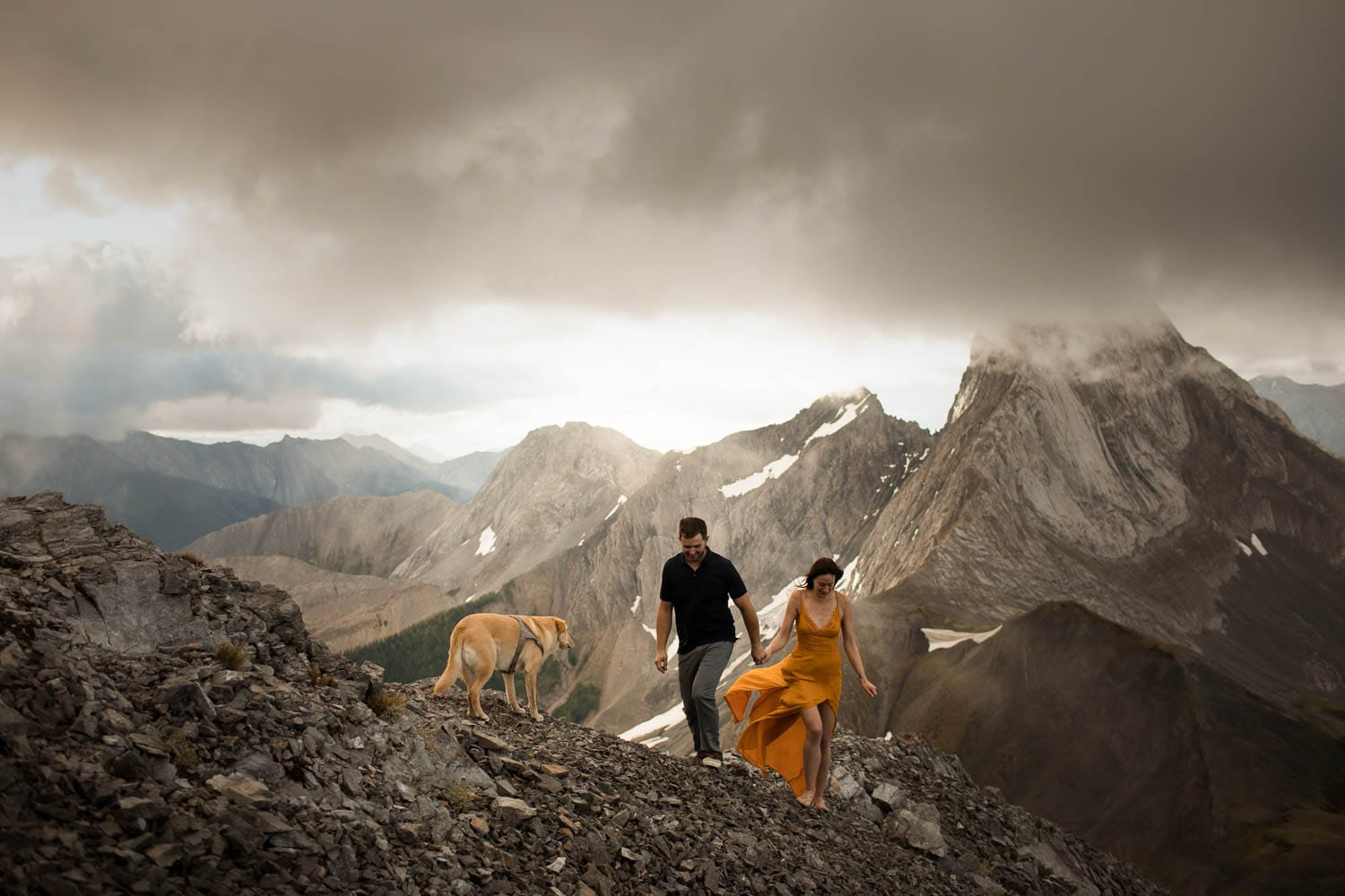 engagement shoot on a  mountain with a dog