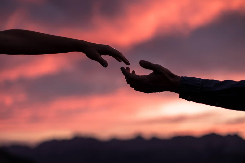 Sunrise hands engagement ring