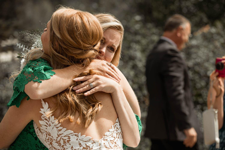 guests hugging bride and groom